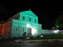 Night photography of old baroque styled church lit by street lights. And flood lights Royalty Free Stock Photos