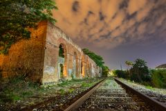 Night photography of an old train station illuminated with warm and cold lanterns in Xátiva, Valencia, Spain stock photography