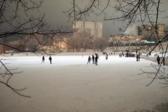 Night photography. People skate at the rink and play hockey late at night stock photos