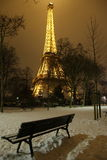 Rare snow in Paris near Eiffel Tower. Night picture of rare snow around the Eiffel Tower in Paris Royalty Free Stock Images
