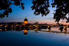 The night piece of Garonne river. In Toulouse France. Saint-Pierre bridge and copper dome of hospital de la Grave. Hospital de la Grave, featuring a copper dome Stock Photos