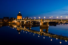 The night piece of Garonne river. In Toulouse France. Saint-Pierre bridge and copper dome of hospital de la Grave Royalty Free Stock Photography