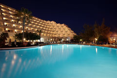 Night pool and Hotel. Hotel with a blue swimming pool at the night stock photo