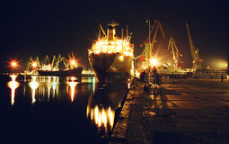 Night port, loading ships. Royalty Free Stock Images