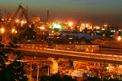 Night port scene with cranes. And bridge Royalty Free Stock Images