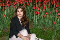 Night Portrait of Hispanic Woman in Tulip Garden Stock Image
