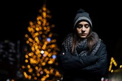 Night portrait of a sad woman feeling alone and depressed in winter.Winter depression and loneliness concept royalty free stock image