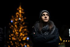 Night portrait of a sad woman feeling alone and depressed in winter.Winter depression and loneliness concept royalty free stock images
