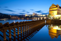 Night Prague. Novotny's footbridge over Vltava river in Prague with the view on Charles bridge and Prague Castle Royalty Free Stock Photo