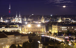 Night Prague cityscape at full moon Stock Photography