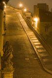 Night Prague fog. Lane to Prague castle from Little Quarter surrounded by Prague fog Royalty Free Stock Images