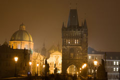 Night Prague fog. Charles bridge and towers of Old Town surrounded by Prague fog Stock Image