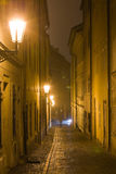 Night Prague fog. Lane in Little Quarter surrounded by Prague fog Stock Images