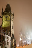 Night Prague fog. St. Teyn gothic cathedral and Old Town Hall on Old Town Square surrounded by Prague fog Royalty Free Stock Photography