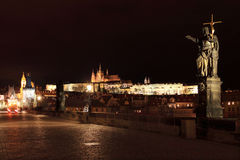 Night Prague gothic Castle from Charles Bridge with Sculptures Royalty Free Stock Image