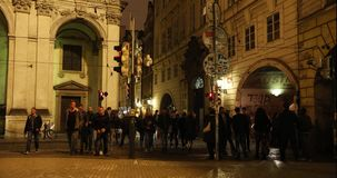 Night Prague, urban traffic on a night street, people cross the highway, Prague Castle, timelapse, Prague. October, 2017 stock footage
