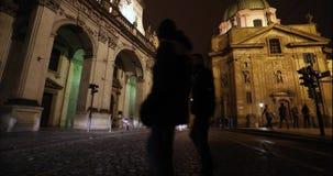 Night Prague, urban traffic on a night street, people cross the highway, Prague Castle, timelapse, Prague. October, 2017 stock video
