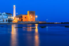 Night at Punta Secca Beach - Montalbano Filming Location. Night at Punta Secca Beach with the lighthouse and the watchtower,Torre Scalambri in Santa Croce royalty free stock images