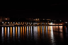 Night quay. Reflection of night lights from the quay Stock Image