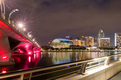 Night Quay in Singapore. The view across the bay to the Singapore night bridge, skyscrapers and bright lights Royalty Free Stock Photos