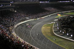 Night racing excitement!. Cars race down the front stretch and into turn 1 at the 2007 Bank of America 500/NASCAR Race for the Chase at Lowes Motor Speedway Stock Photography