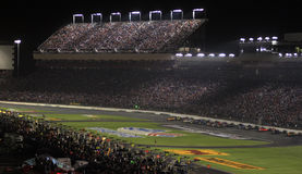 Night Racing at Lowes Motor Speedway. A view  of the infield and front stretch from between turns 3 & 4 during the Bank of America 500, October 2007  at Lowes Royalty Free Stock Photos