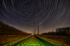 Night rails -green way with stratrails skyes Royalty Free Stock Photo