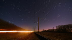 Night rails - train way with motion stars, stratrails skyes timelapse. Night rails -green light train way with motion stars, stratrails skyes timelapse stock video
