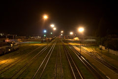 Night railway. Railway station at night time. The Type with bridge Stock Image