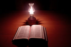 Night reading the bible. Stock Images