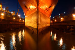 Night receipt. Entering the ship to dock at the shipyard repair class Stock Photography
