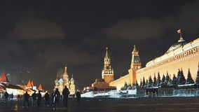 Night Red Square Kremlin St. Basil`s Cathedral slider. MOSCOW, RUSSIA - JAN 2017: Night Red Square Kremlin St. Basil`s Cathedral slider. Kremlin Clock or chimes stock video