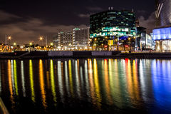Night Reflections on a quick water. Reflections on a quick water at night from a highlighted industrial buildings in Salford, Manchester, United Kingdom Royalty Free Stock Image