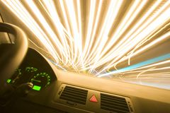 Night Rider. City light trails shot from inside a car royalty free stock images
