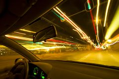 Night Rider. City light trails shot from inside a car Royalty Free Stock Photos