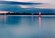 Night river skyline with red lights. Red luminous buoy on the night river - skyline Stock Photography