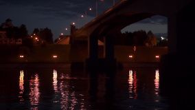 Night river under the bridge stock footage