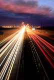 Night road. Traffic lights in motion blur royalty free stock photo