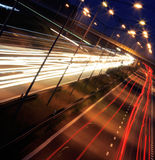 Night road. Traffic lights in motion blur royalty free stock photography