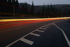 Night road. The lights of cars on the motorway at night Royalty Free Stock Photo