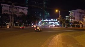 Night road in Asia. Crossroad. Nha Trang, Vietnam - 03 March, 2017. Night road in Asia. Many motorbikes drives through crossroad. Haos movement at first look stock footage