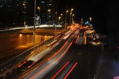 Blurred road with colorful night lights royalty free stock photography