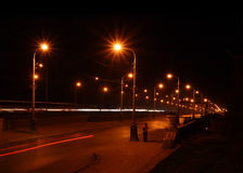 Night road through bridge Stock Images