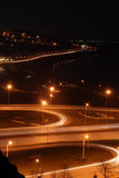 Night road junction and embankment Stock Photos