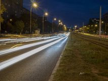 Night road light ribbons on the asphalt. When night come on the road light ribbons visible interesting on the asphalt stock images