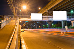 Night road long exposure with blank billboard Stock Images