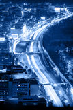 Night road with motion traffic in the city, blue Royalty Free Stock Photography
