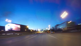 Night road POV through the city at night timelapse stock footage