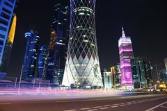 Night road traffic in financial centre in Doha, Qatar. QATAR, DOHA, MARCH 20, 2018: Night road traffic in financial centre in Doha - capital and most populous stock photography