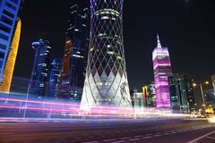 Night road traffic in financial centre in Doha, Qatar. QATAR, DOHA, MARCH 20, 2018: Night road traffic in financial centre in Doha - capital and most populous royalty free stock photo